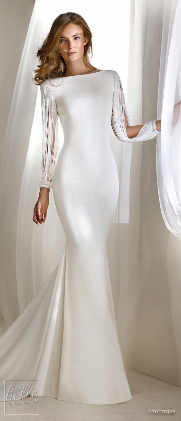 vestido de novia largo pegado al cuerpo con mangas